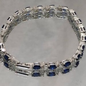 SILVER TONE FAUX BLUE DIAMOND SET BRACELET